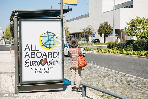 istock Photo of the image with official Eurovision symbols Eurovision Song Contest 2018 Lisbon. A poster on the city street. 955141460