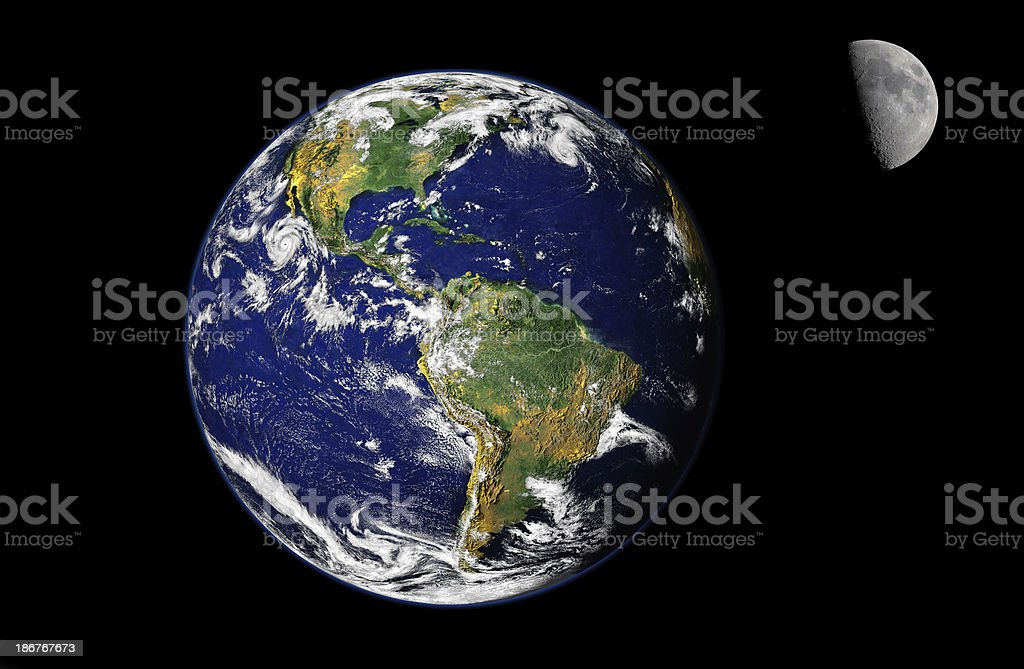 A photo of the planet earth with the moon royalty-free stock photo