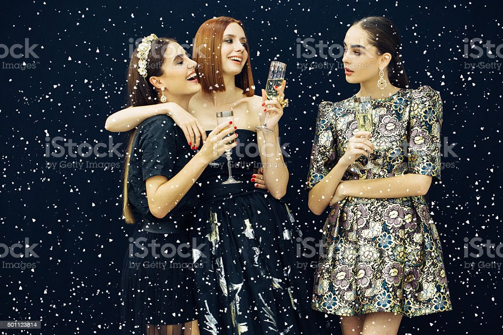 Photo of three laughing girls strewn snow stock photo