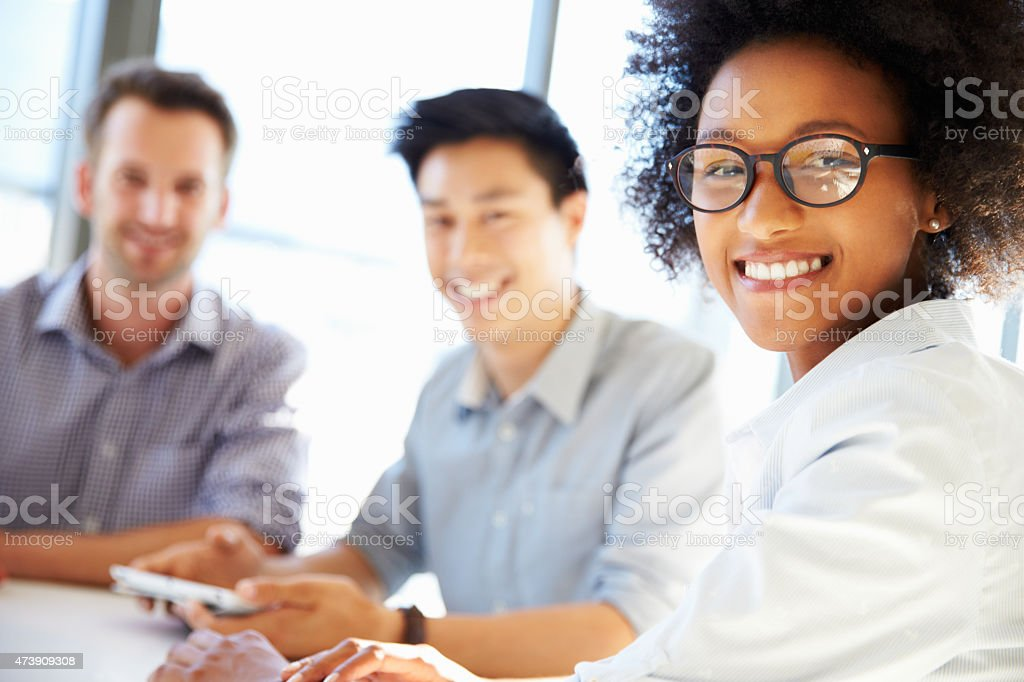 Three business professionals working together