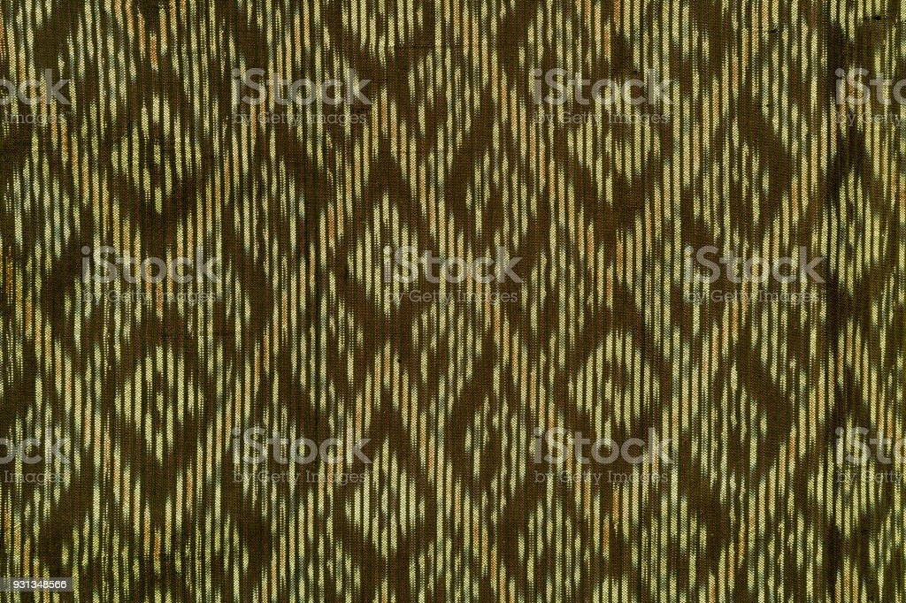 Photo of traditional thailand sarong Geometric ethnic pattern for carpet,wallpaper,clothing,wrapping,Batik,fabric,sarong, design and creative concept stock photo