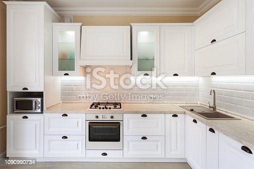 istock Photo of upscale interior with bright light kitchen cabinet and other designer elements 1090990734