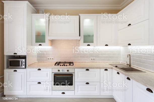 Photo of upscale interior with bright light kitchen cabinet and other picture id1090990734?b=1&k=6&m=1090990734&s=612x612&h=abstt5hjpfd30ol g6ecmhxnbgi6pagraf68rm63kns=
