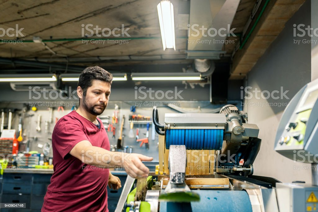 Photo of Winter shop worker doing base repair stock photo