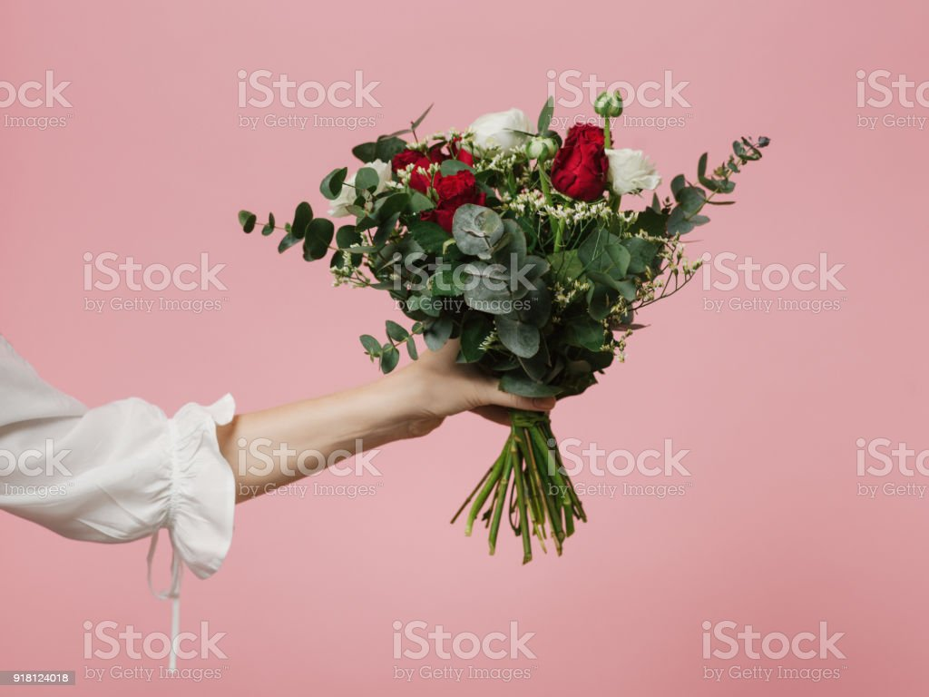 Photo of woman holding beautiful bouquet of flowers roses pink background royalty-free stock photo