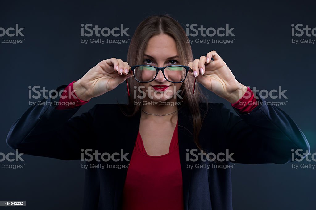 Photo of woman holding glasses stock photo