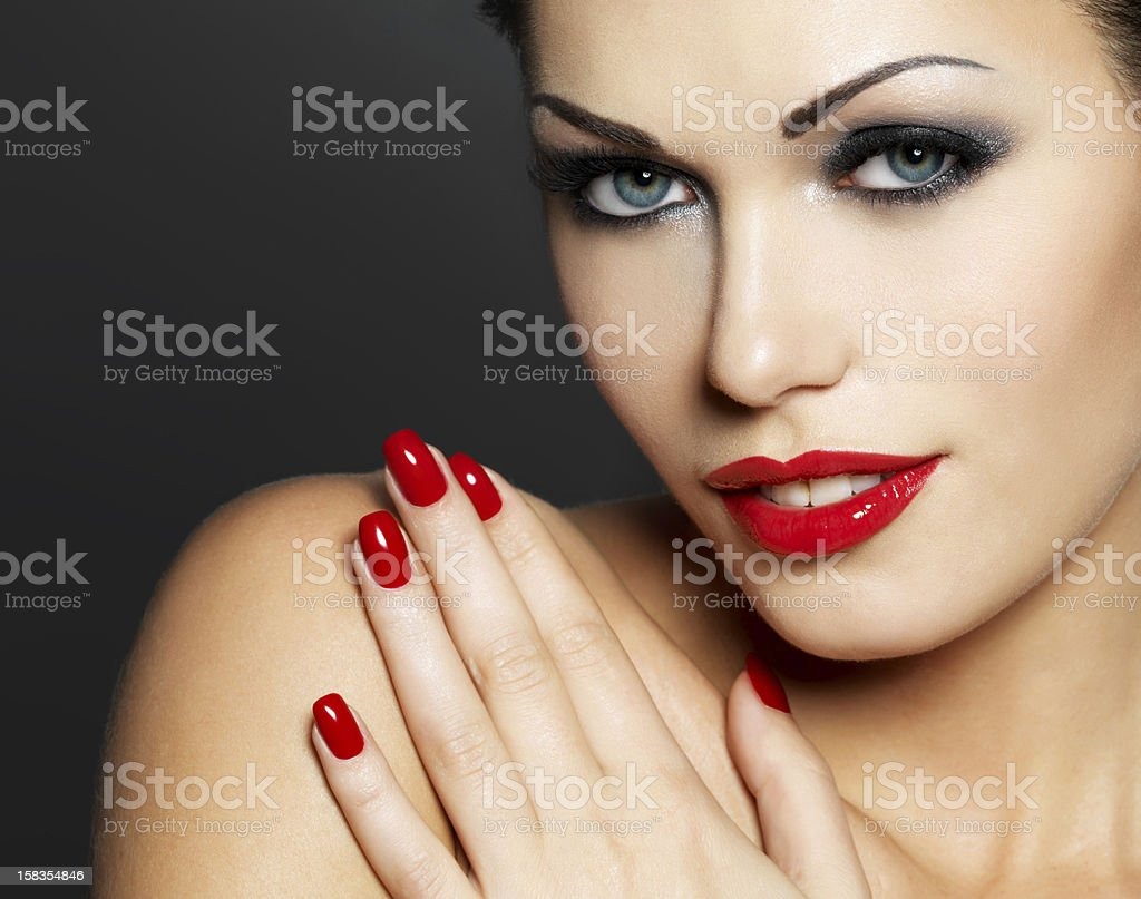 Photo of woman with fashion red nails and  lips royalty-free stock photo