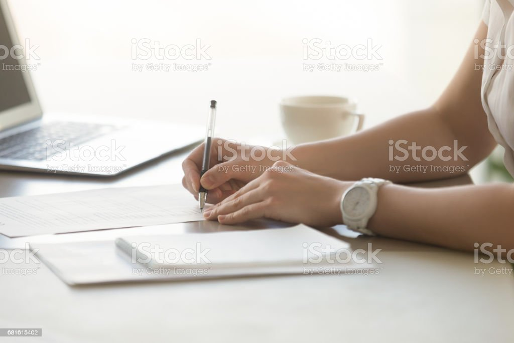 Photo of womans hands with pen signs contract stock photo