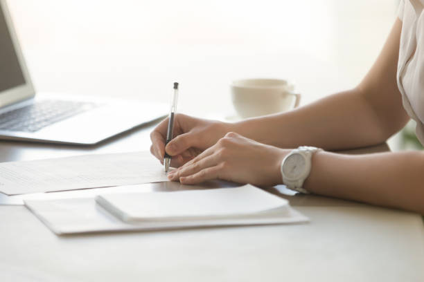 photo of womans hands with pen signs contract - form document stock pictures, royalty-free photos & images