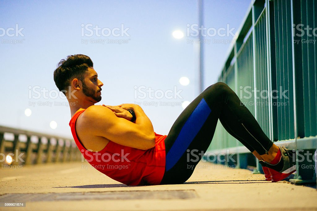 Photo of young athlete exercising outdoors in summer evening – Foto