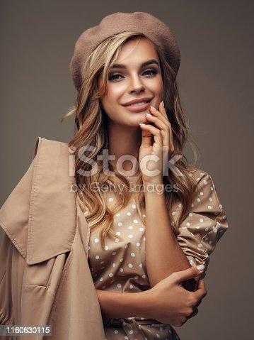 Photo of young beautiful woman wearing stylish