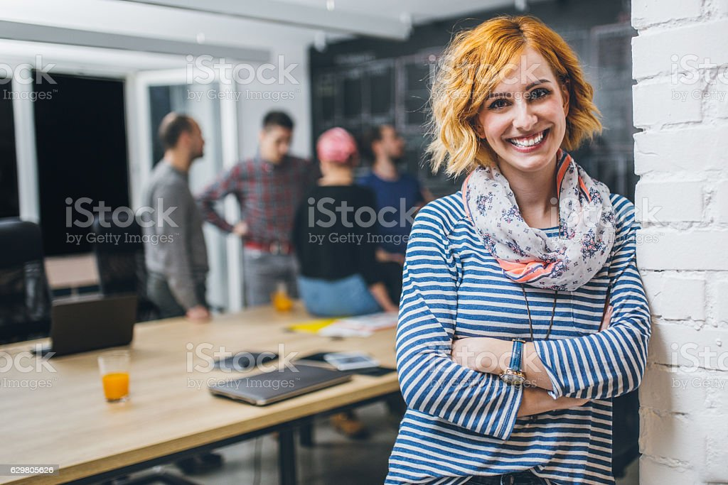 Photo of young business woman in a conference room