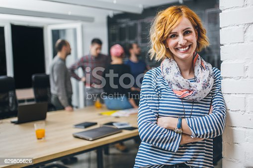 istock Photo of young business woman in a conference room 629805626