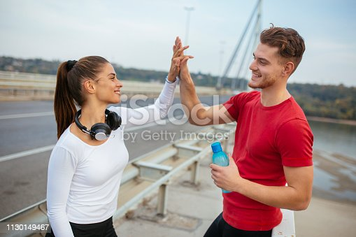 670054434istockphoto Photo of young couple high five after training 1130149467