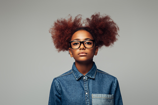 Photo of young curly girl with glasses
