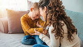istock Photo of young mother bonding with her son 1214508304