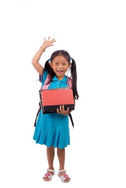Photo of young student standing and raising her hand stock photo