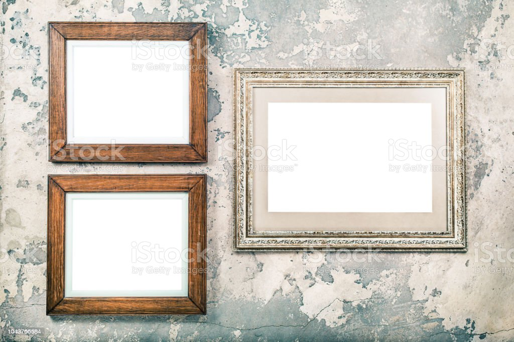 Photo or picture frame blank hanging on vintage aged grunge textured concrete wall background. Retro old style filtered photo stock photo