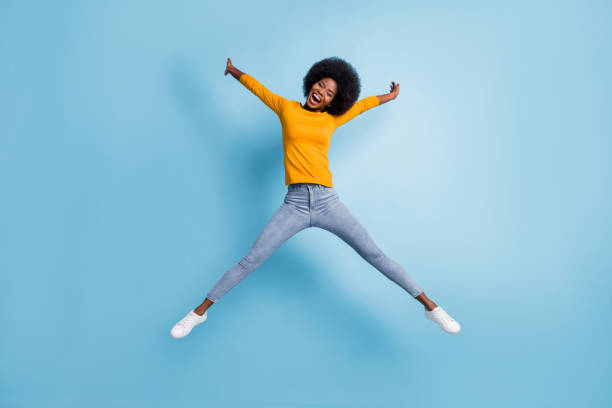 Photo portrait full body of woman jumping up spreading like star isolated on pastel blue colored background stock photo
