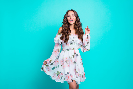 Photo portrait of attractive pretty cute lovable fascinating delicate alluring gorgeous nice stunning with long wavy hairdo shirt mini white dress holding frill chiffon isolated on vivid background