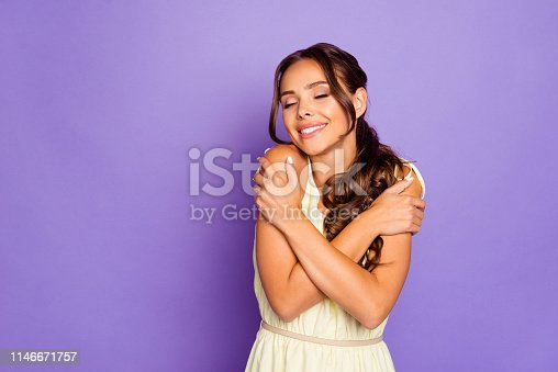 istock Photo portrait of nice pretty fascinating with toothy teeth beaming smile she her lady in spring costume she her lady hugging missing her self with hands closing eyes isolated violet background 1146671757
