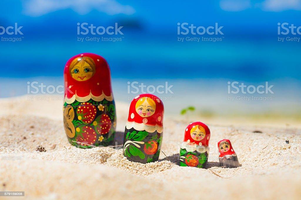 Photo Rows Puzzle Russian Dolls Matrioshka Souvenir Untouched Tropical Beach стоковое фото