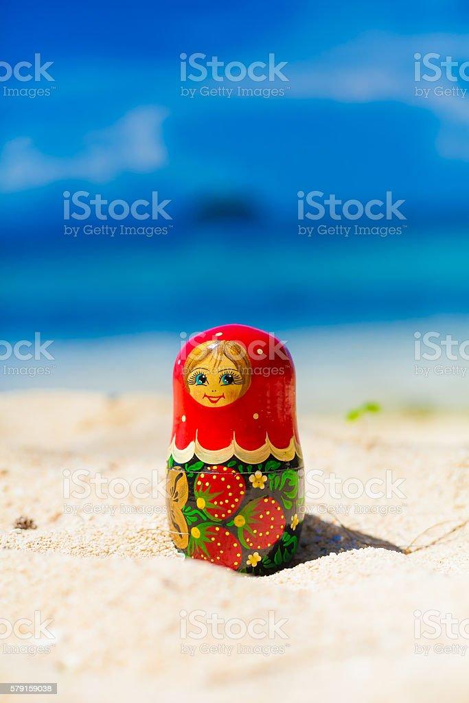 Photo Russian Dolls Matrioshka Souvenir Untouched Sunny Tropical Beach in stock photo