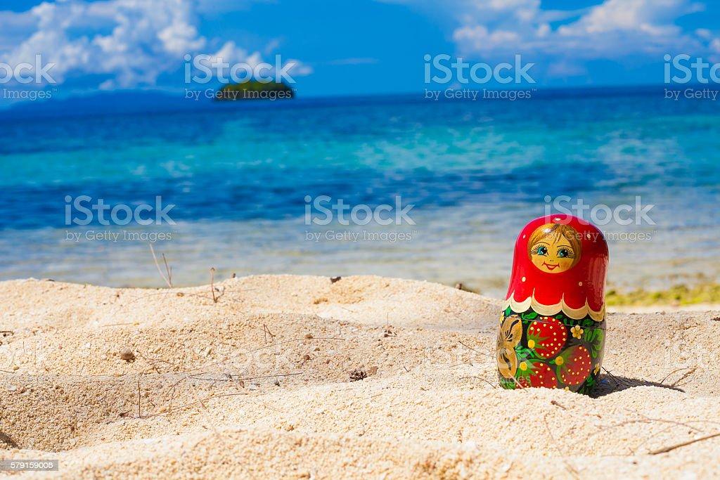 Photo Russian Dolls Matrioshka Souvenir Untouched Tropical Beach in Bali stock photo