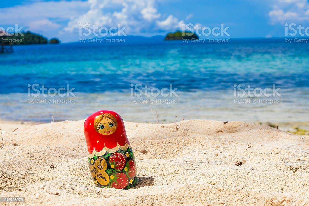 Photo Russian Handmade Dolls Matrioshka Untouched Tropical Beach in Bali stock photo