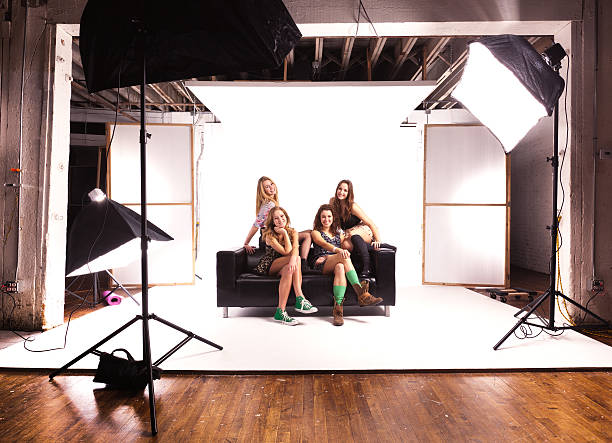 Photo Shoot Session with Young Teen Girl Models on White stock photo
