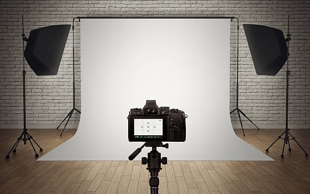 Photo studio light setup with digital camera stock photo