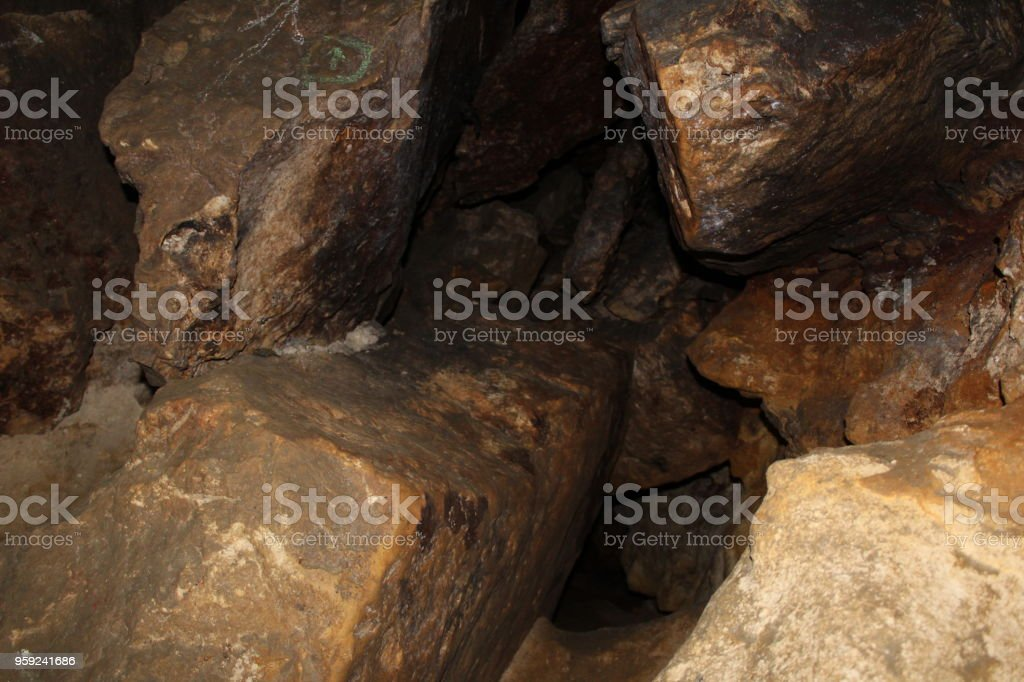 Photo underground, quarry created artificially for the extraction of stone and created by nature. stock photo