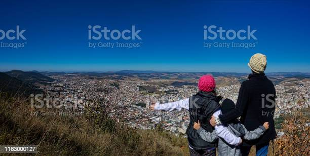 Photo of Photo with mother with daughter and son  on top of the mountain watching the city Poços de Caldas - Minas Gerais / Brazil - below.