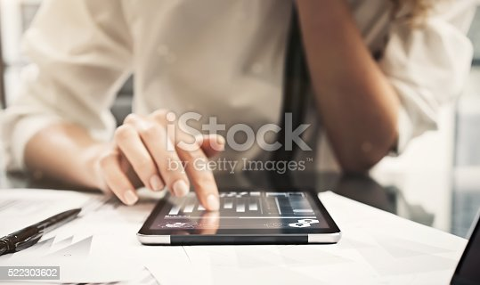 517496962 istock photo Photo woman reading market reports modern tablet and touching screen 522303602
