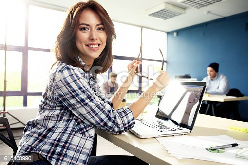 istock Photo woman working with new startup project in modern loft. 615408990