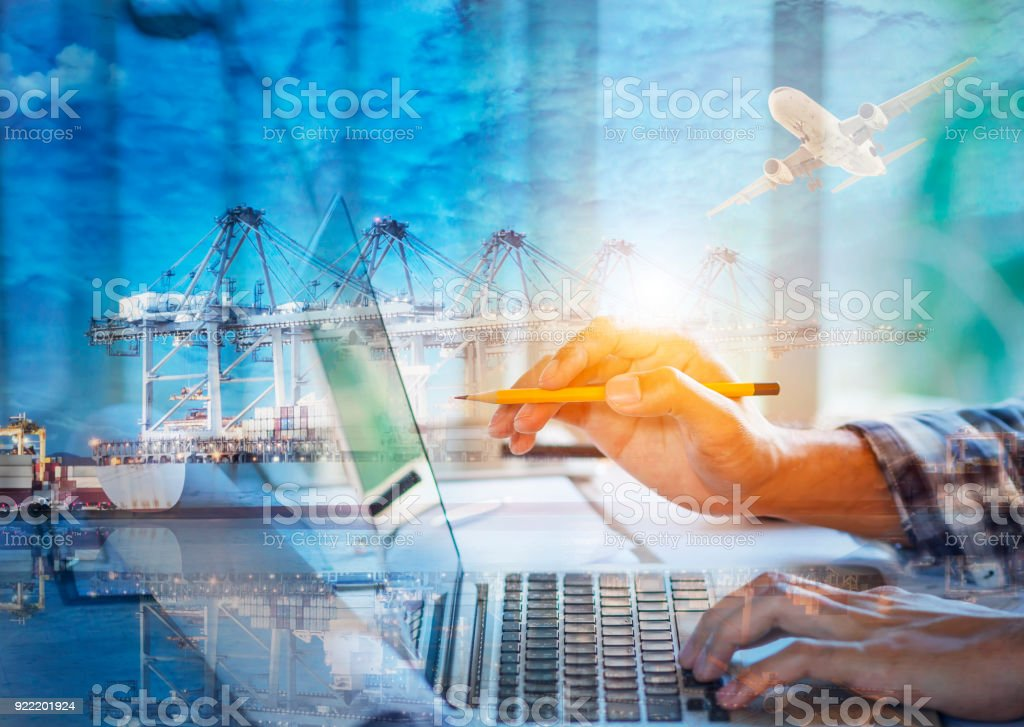 Photo young account managers crew working with new startup project. Notebook on wood table. Double exposure photo of Containers loading by crane at Sunset. royalty-free stock photo