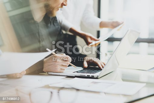 istock Photo young coworkers crew working with new startup project in 517496912