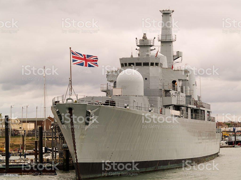 Photograph of a British naval ship at port stock photo