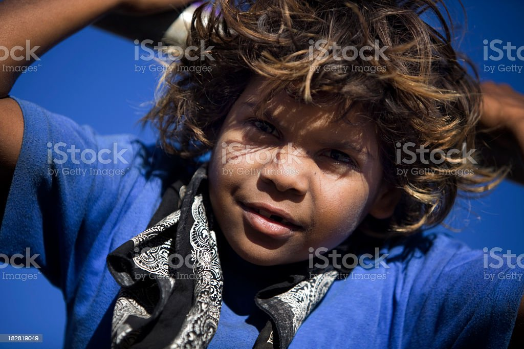 A photograph of a child wearing a black bandana  stock photo