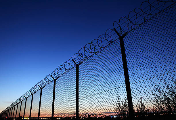 Photograph of a fence for a restricted area stock photo