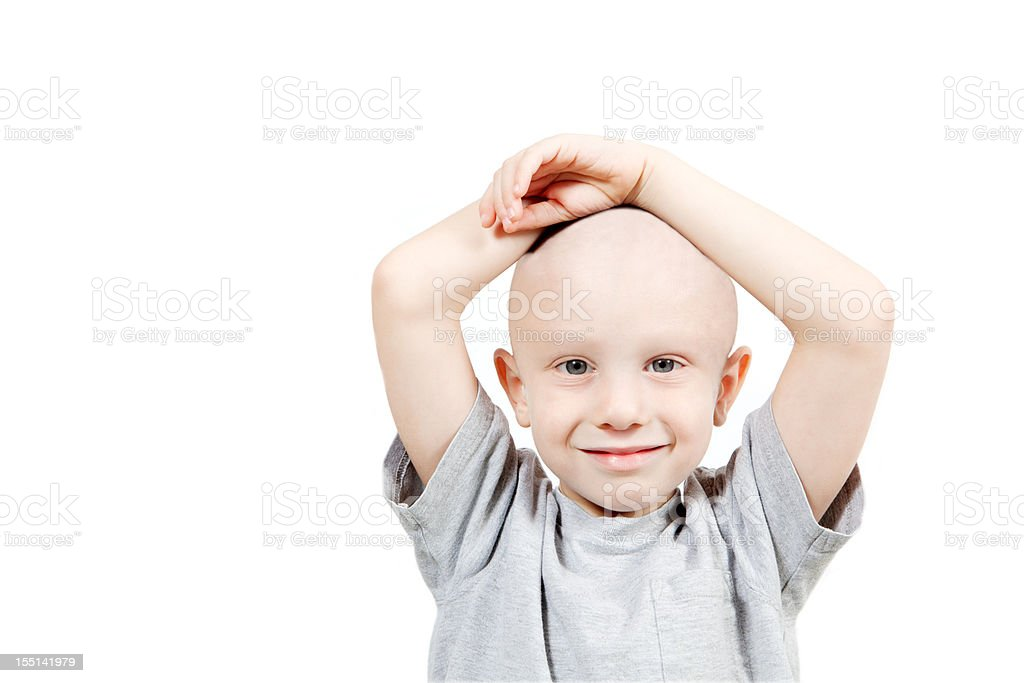 Photograph of a happy child undergoing chemotherapy stock photo