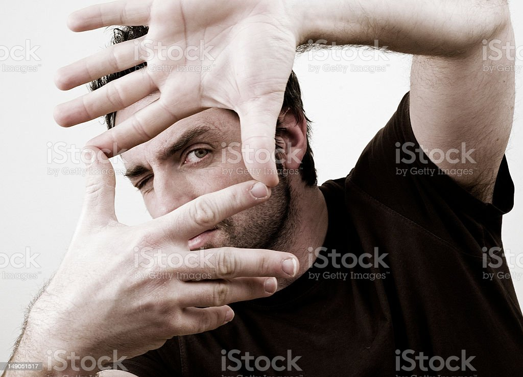 Photograph of a man posing for the camera with hand gesture royalty-free stock photo