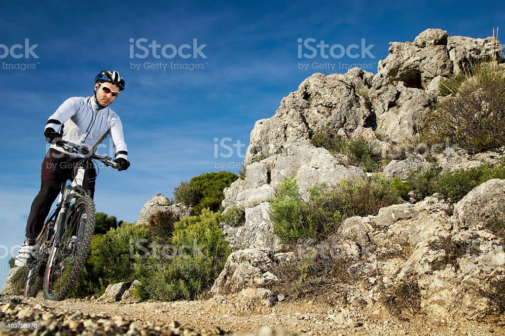 Photograph of a man riding a mountain bike on a mountain royalty-free stock photo