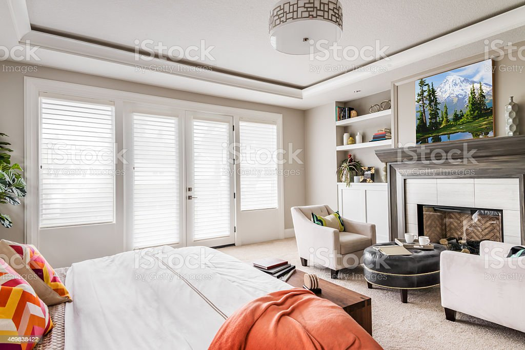 A photograph of a modern bedroom in white stock photo