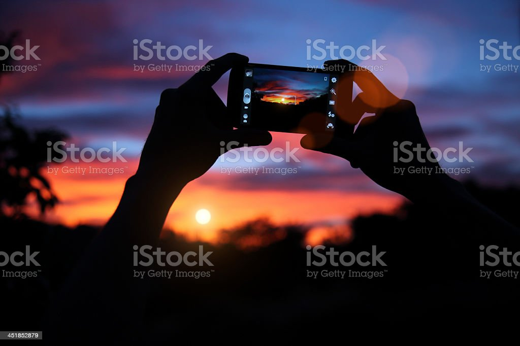 Photograph of a photo being taken with a cell phone stock photo