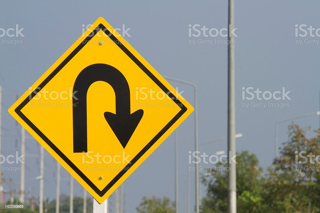 Photograph of a U-turn road sign stock photo