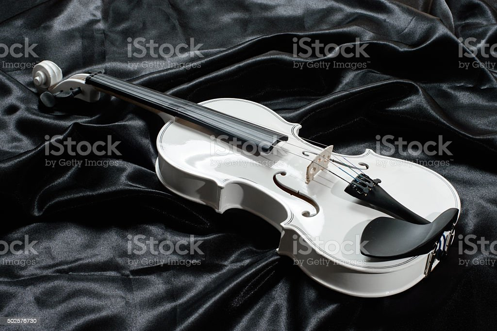 Photograph of a white violin stock photo