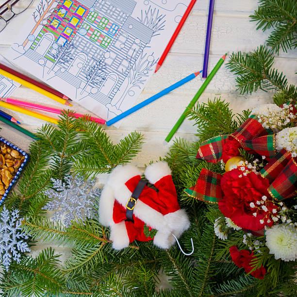 photograph of adult coloring book page with christmas arrangement - ausmalbilder weihnachtsmann stock-fotos und bilder