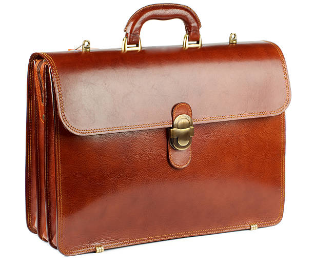 Photograph of brown leather briefcase Ginger Leather Briefcase with Gold Details isolated on white background briefcase stock pictures, royalty-free photos & images