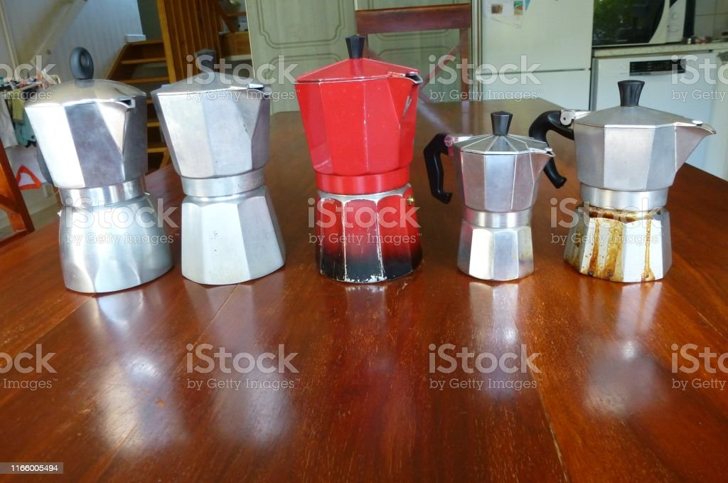 photograph of coffee machines on a table